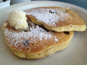 Mouthwatering Almond Joy pancakes at Butter Cafe.